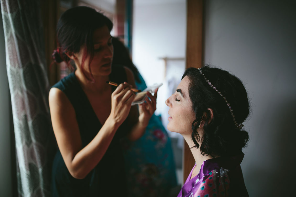 Bride putting on make up at Stinson Beach Wedding by Becca Henry Photography