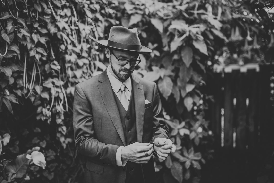 Groom adjusting cufflinks for Stinson Beach Wedding by Becca Henry Photography