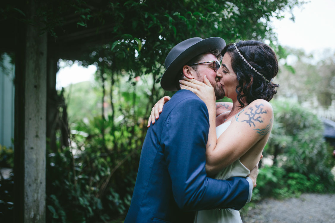 Kiss after the first look at foggy Stinson Beach Wedding by Becca Henry Photography