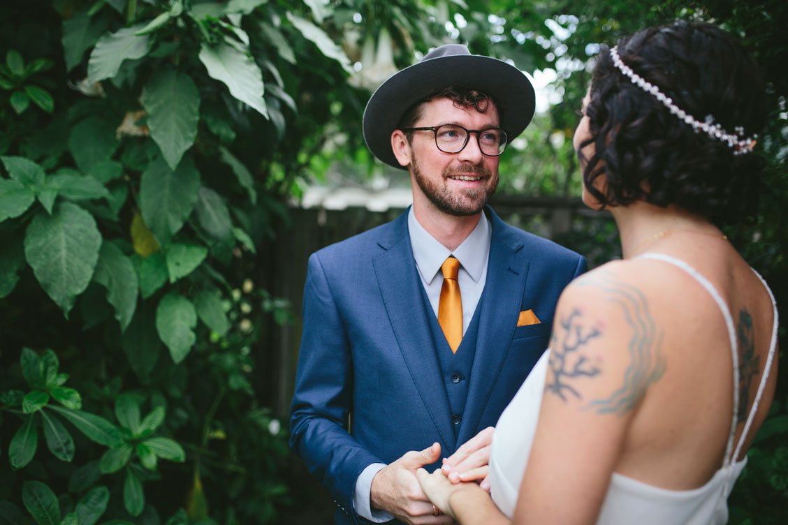 Groom sees bride for first time by Becca Henry Photography