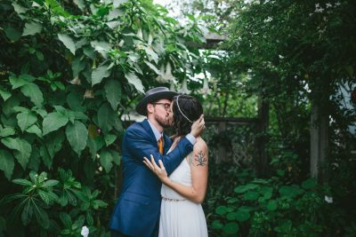 Stinson Beach Wedding - garden kiss by Becca Henry Photography