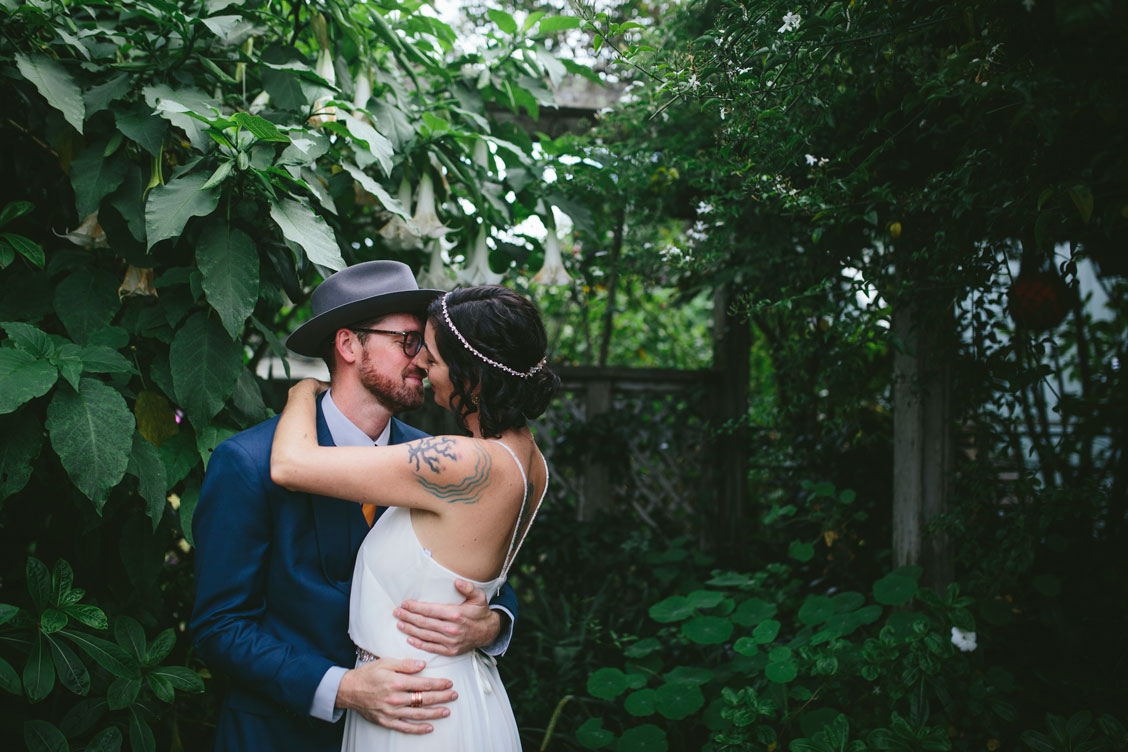 Groom embraces bride at Stinson Beach Wedding by Becca Henry Photography