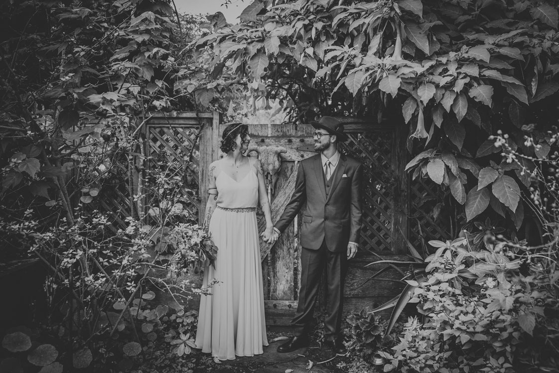 holding hands in a beautiful garden by Becca Henry Photography