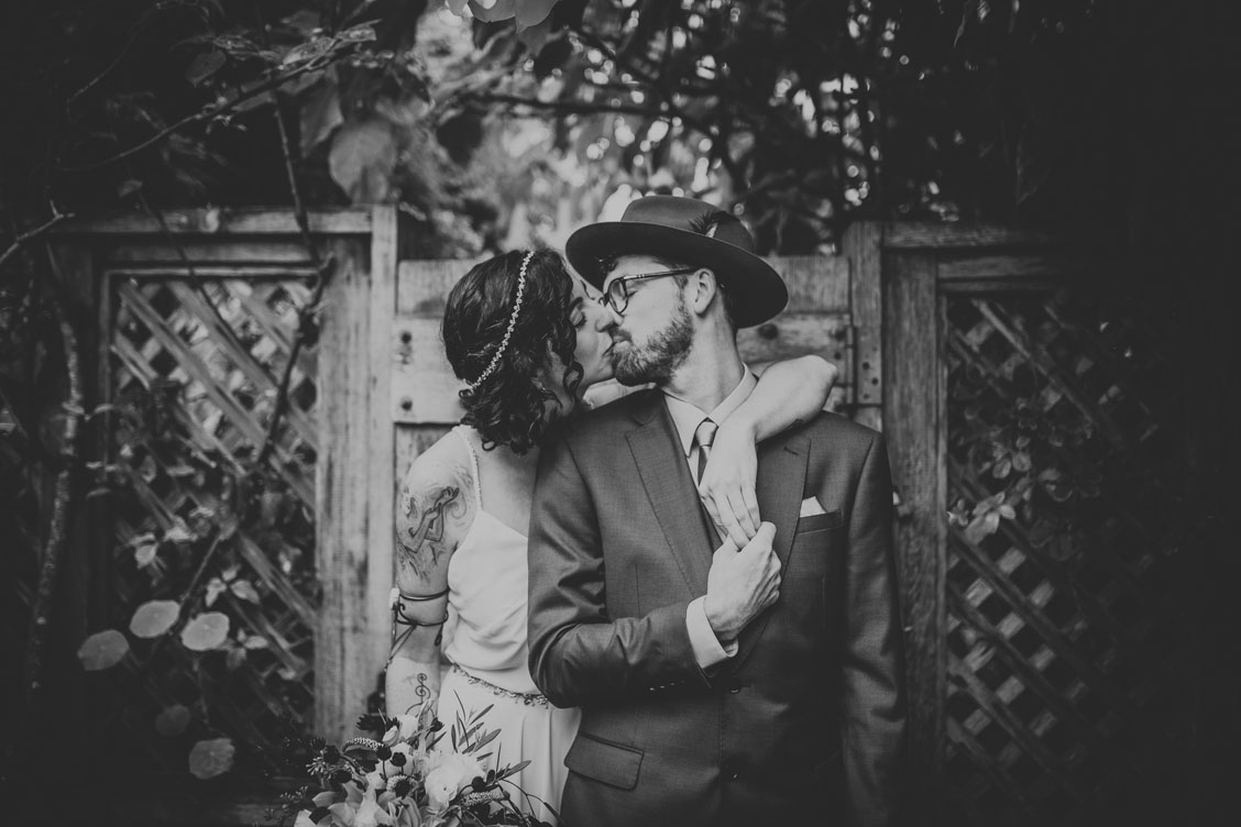 Portrait of wedding couple in a beautiful garden by Becca Henry Photography