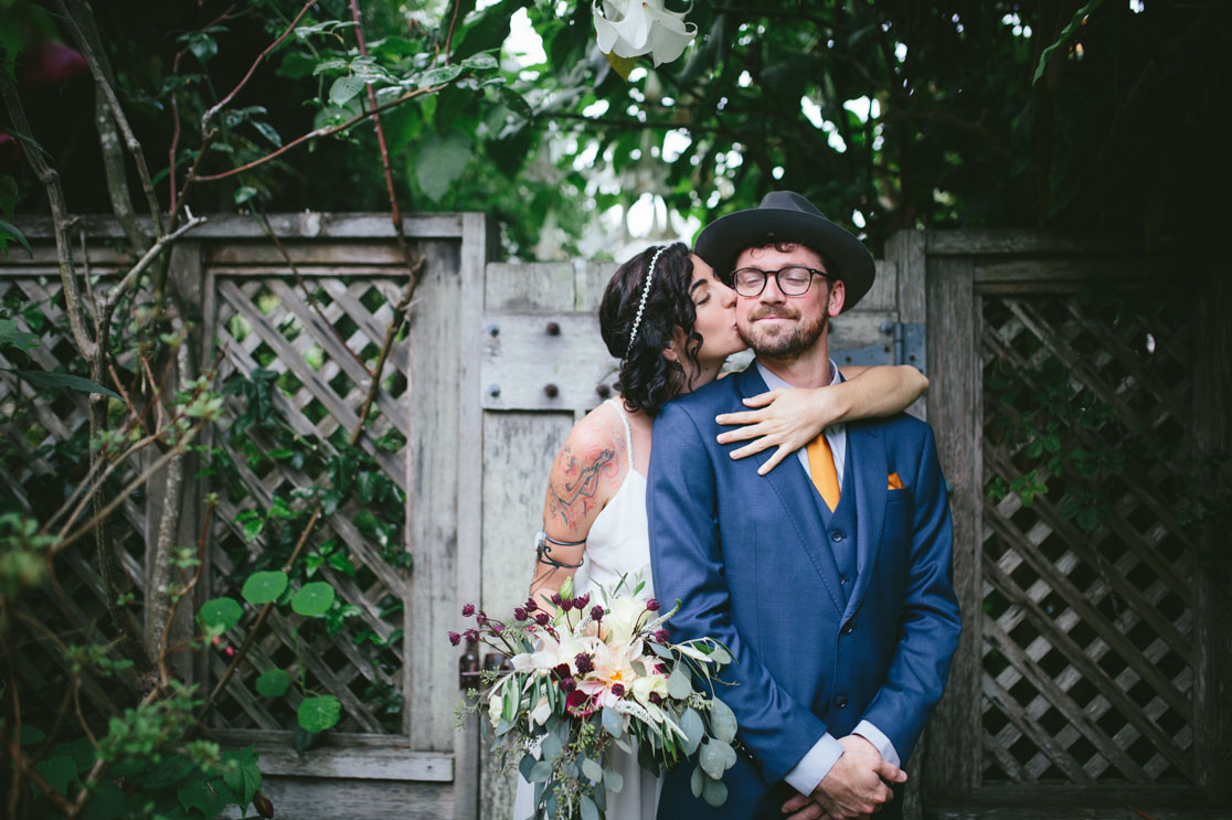 Stinson Beach Wedding Couple in in the garden by Becca Henry Photography