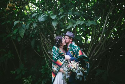 Snuggles under a Pendleton blanket at Stinson Beach wedding by Becca Henry Photography