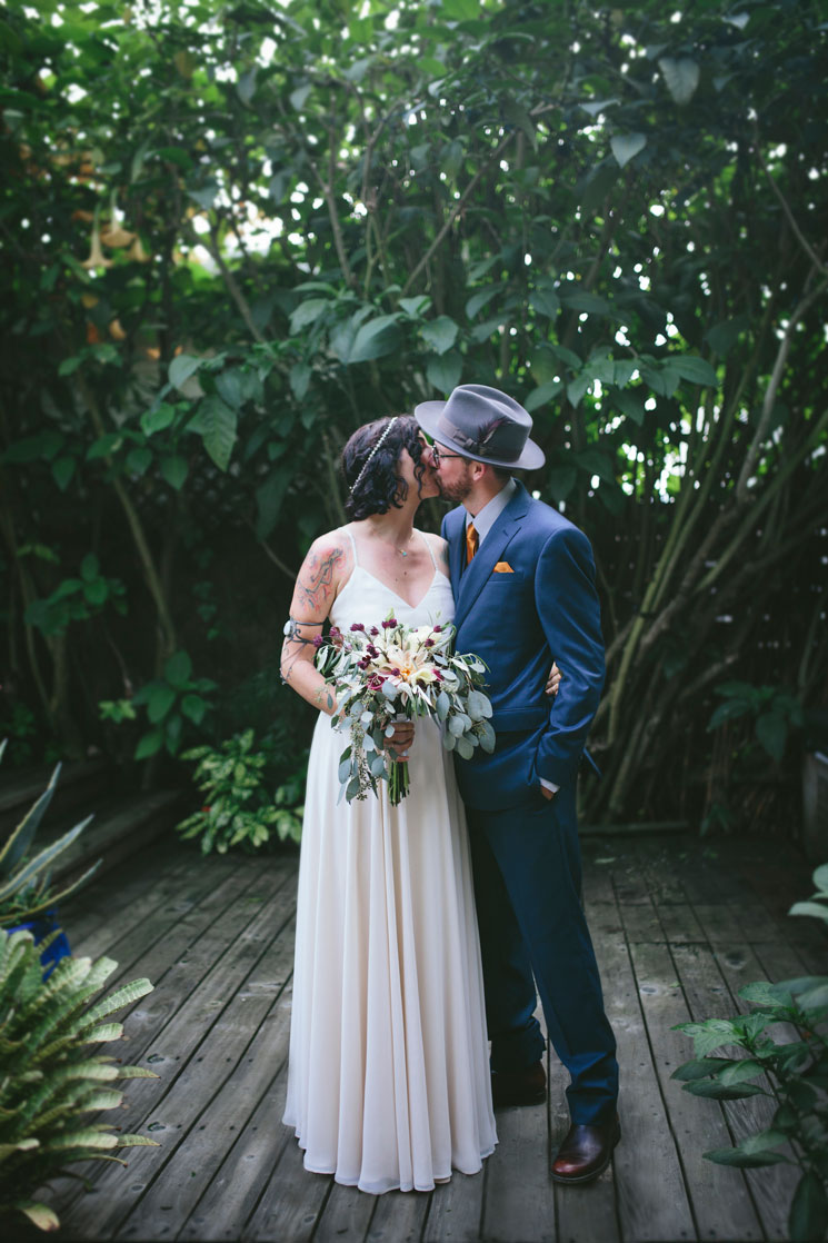 Portrait of bride and groom at lovely beach wedding by Becca Henry Photography