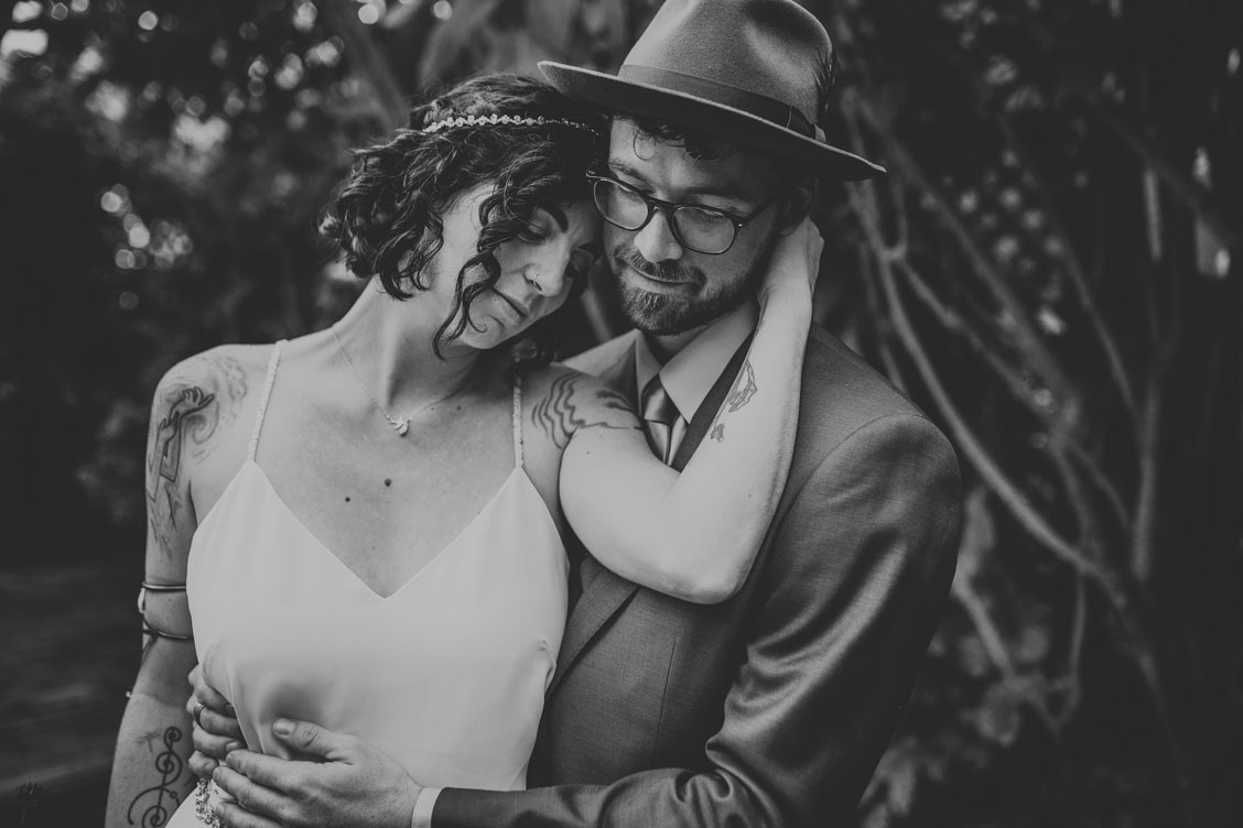 Groom holds bride at California wedding by Becca Henry Photography
