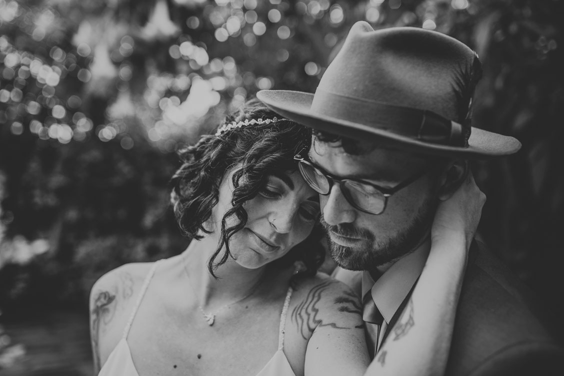 BW image of sweet moment at Stinson Beach wedding by Becca Henry Photography