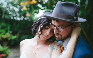 Stinson Beach Wedding- the couple in the lush garden by Becca Henry Photography