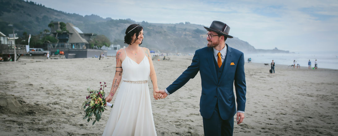 Holding hands on the beach at Stinson Beach Wedding by Becca Henry Photography