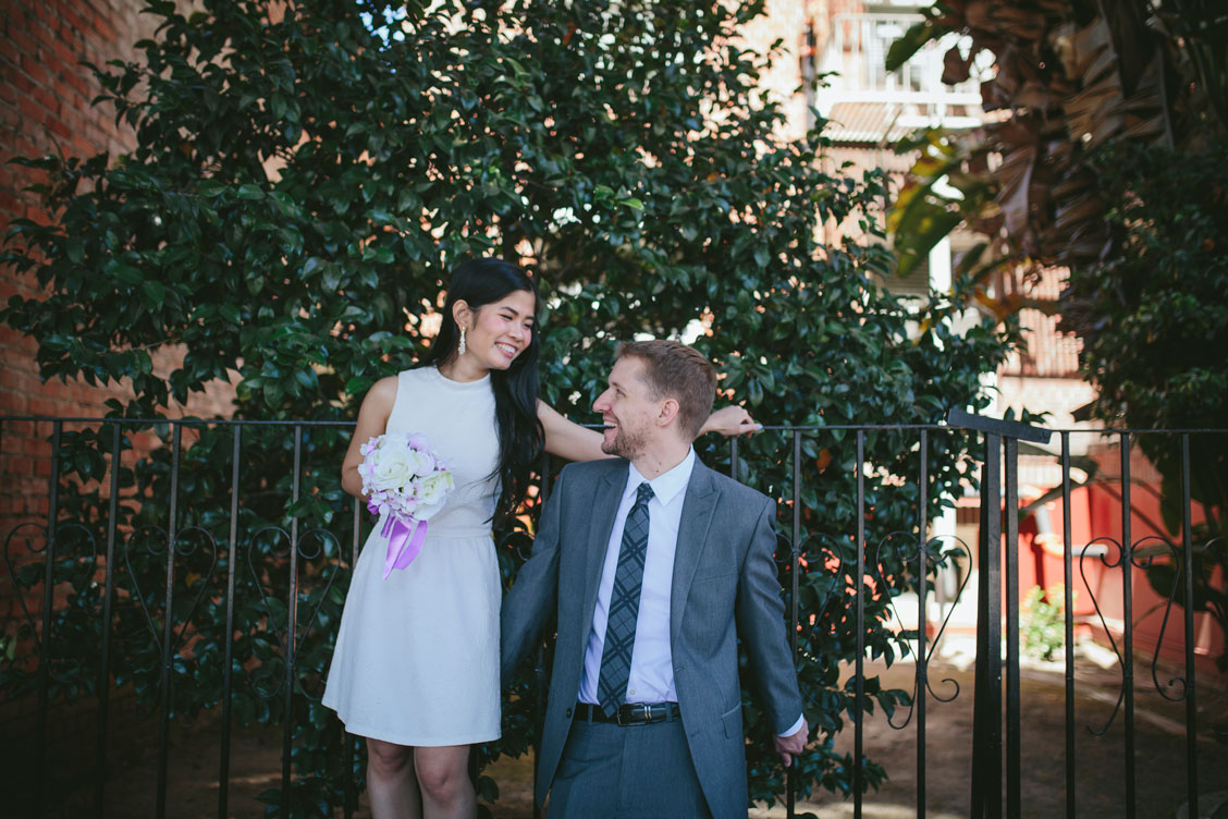 Oakland wedding -couple walking through the city by Becca Henry Photography
