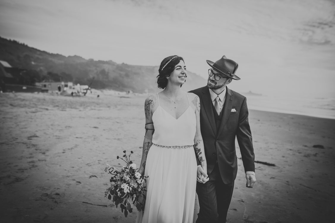 Wedding couple walks on the beach at Stinson Beach wedding by Becca Henry photography