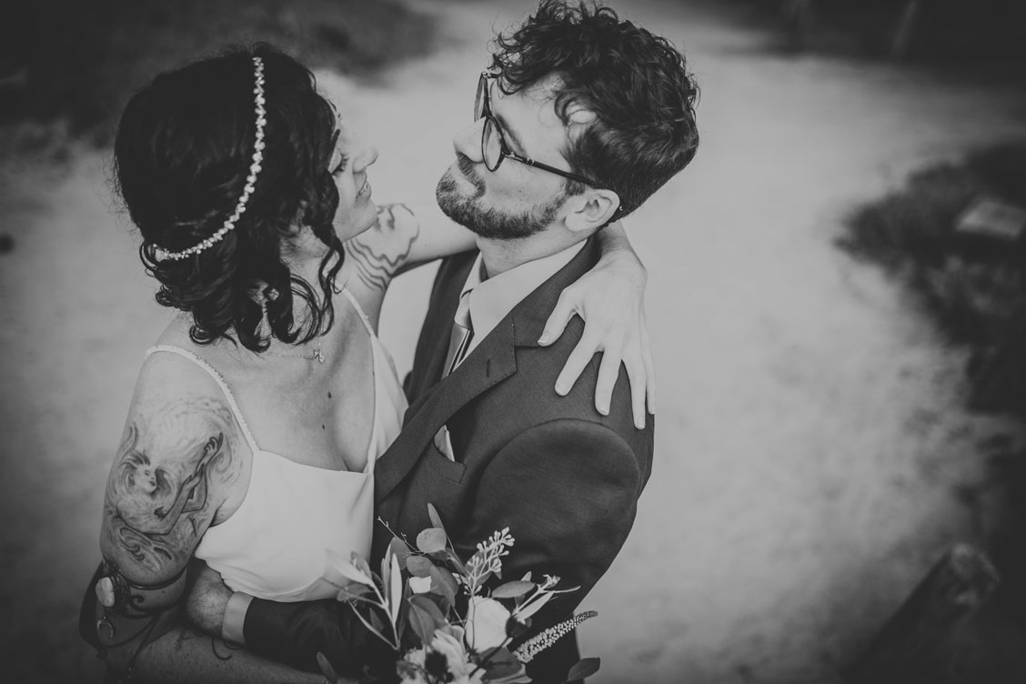 Couple's embrace before wedding ceremony at Stinson Beach wedding by Becca Henry Photography
