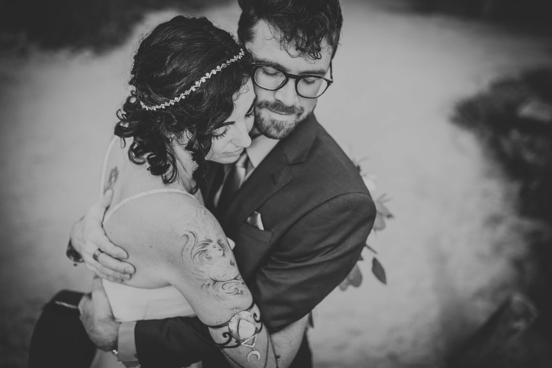 Couple embrace before wedding ceremony at Stinson Beach wedding by Becca Henry Photography