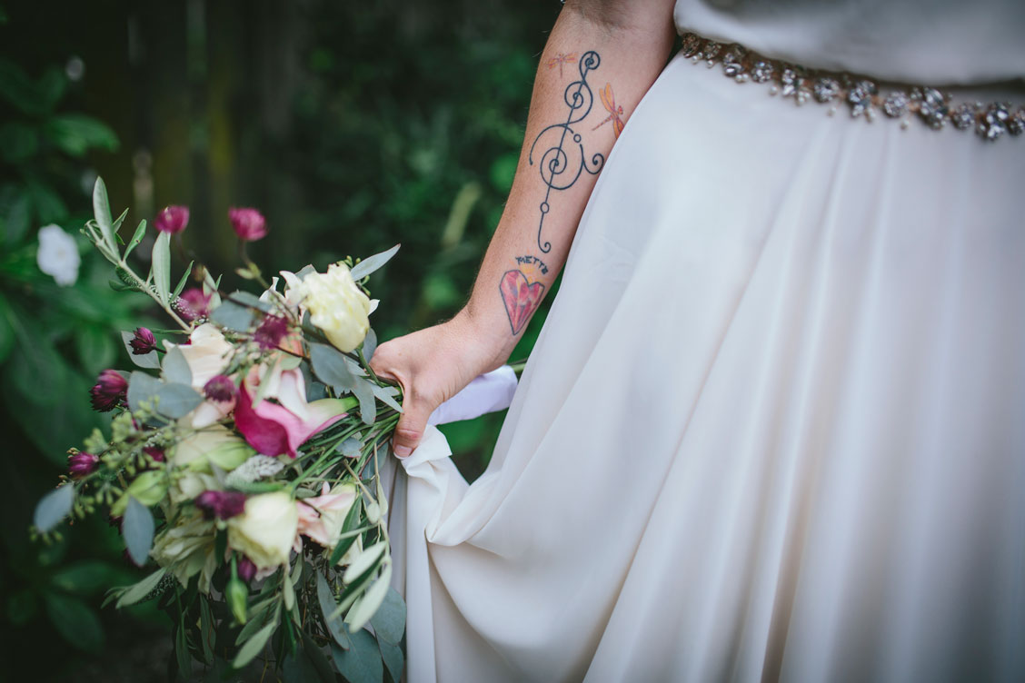 Tatted bride with bouquet by Becca Henry Photography