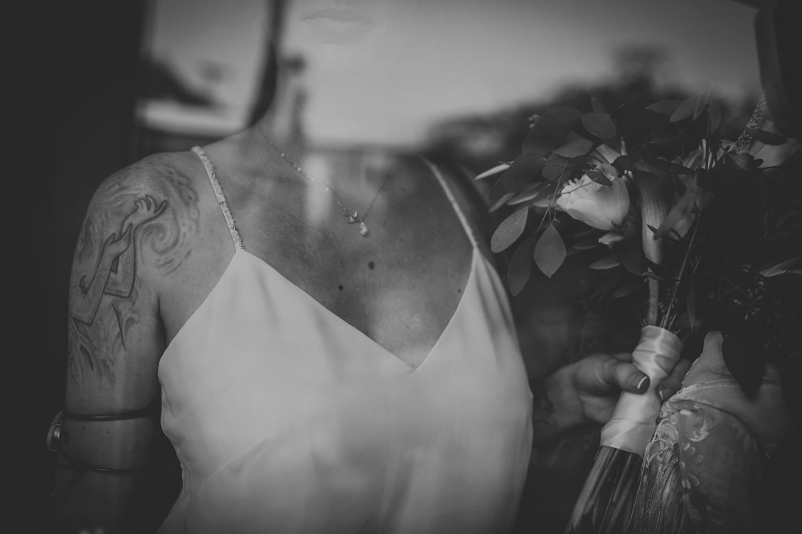 Creative, moody photography of bride with bouquet by Becca Henry Photography