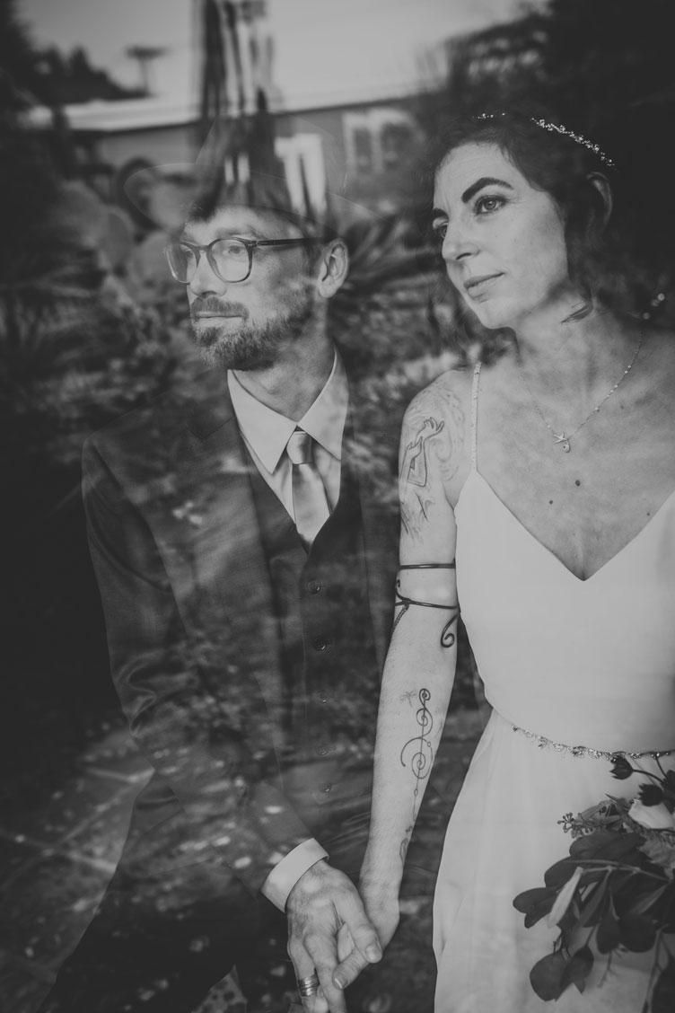 BW image of Couple holding hands before the ceremony for moody creative wedding by Becca Henry Photography