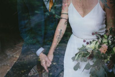 Stinson Beach Wedding - holding hands with bouquet by Becca Henry Photography