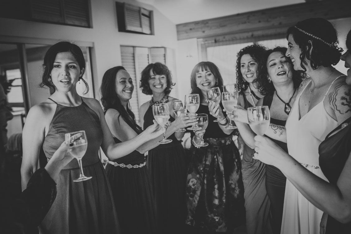Bridal party champagne cheers by Becca Henry Photography