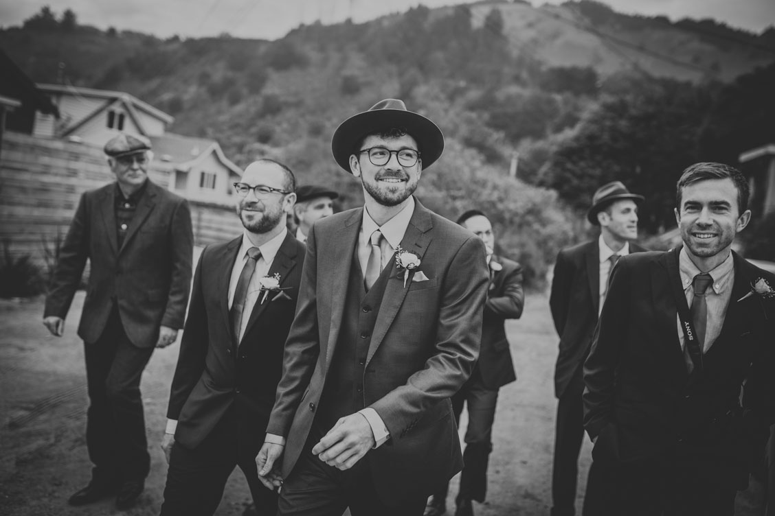 Groom walking to the ceremony at Stinson Beach Wedding by Becca Henry Photography