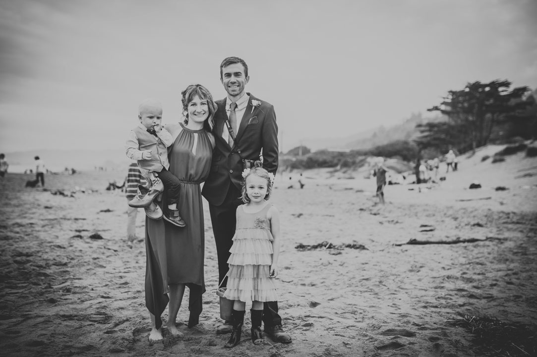 Family portrait on beach at Stinson Beach Wedding by Becca Henry Photography