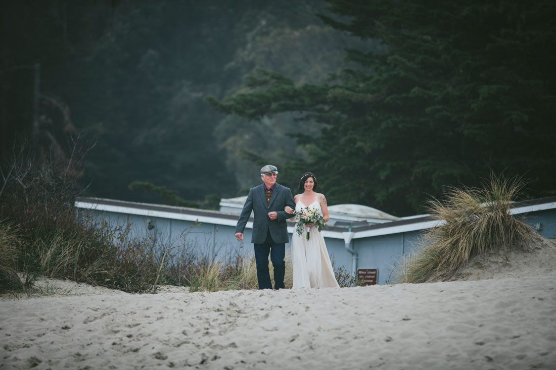 Bride coming down the aisle at Stinson Beach Wedding by Becca Henry Photography