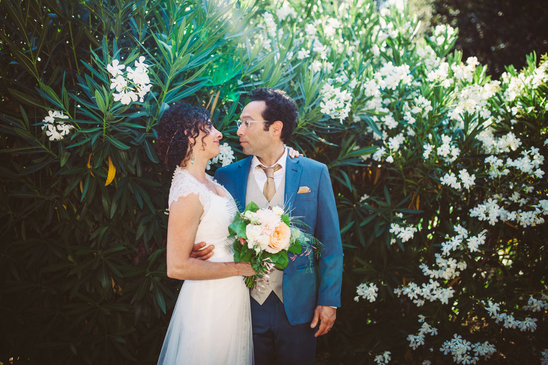 San Rafael Wedding - kissing in the garden by Becca Henry Photography
