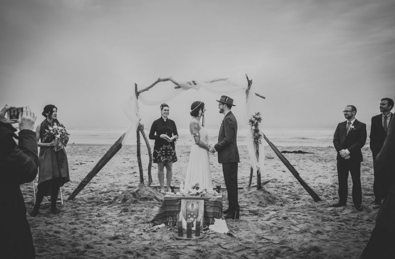 BW image of couple reciting vows on beach at Stinson Beach Wedding by Becca Henry Photography