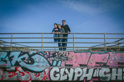 Family portrait in front of mural at Ocean Beach, SF by Becca Henry Photography