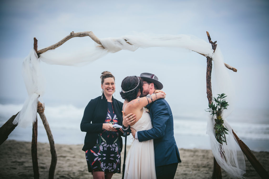 Just married couple kissing on beach at Stinson Beach Wedding by Becca Henry Photography