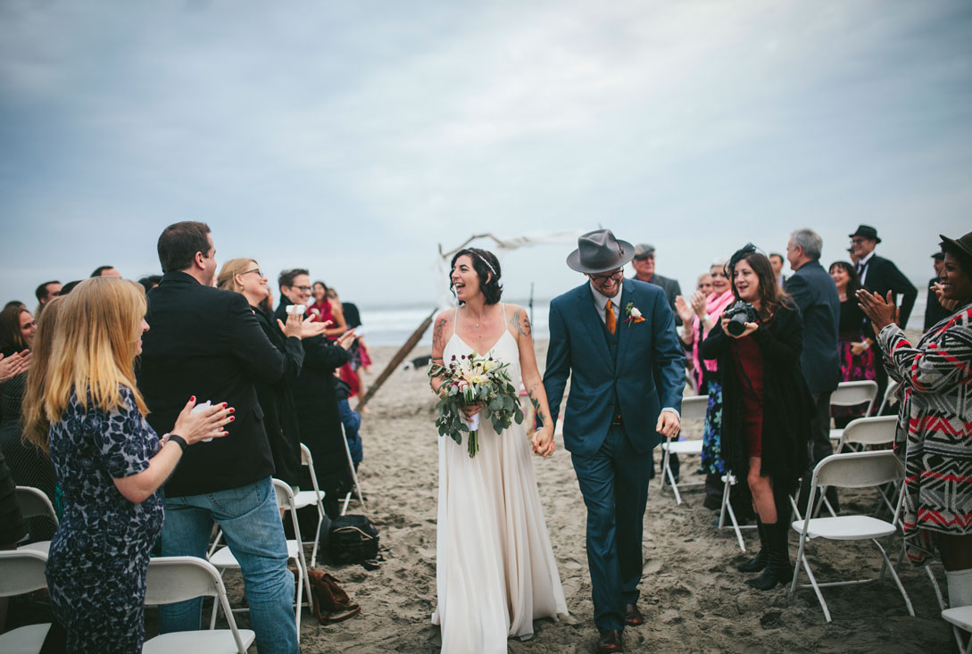 Just married couple coming down the aisle at Stinson Beach Wedding by Becca Henry Photography