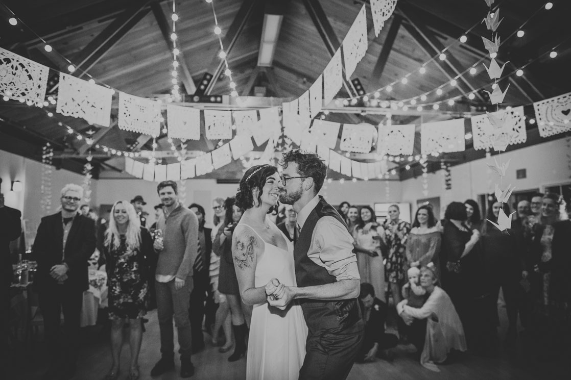 Just married couple dancing at DIY wedding, Stinson Beach by Becca Henry Photography