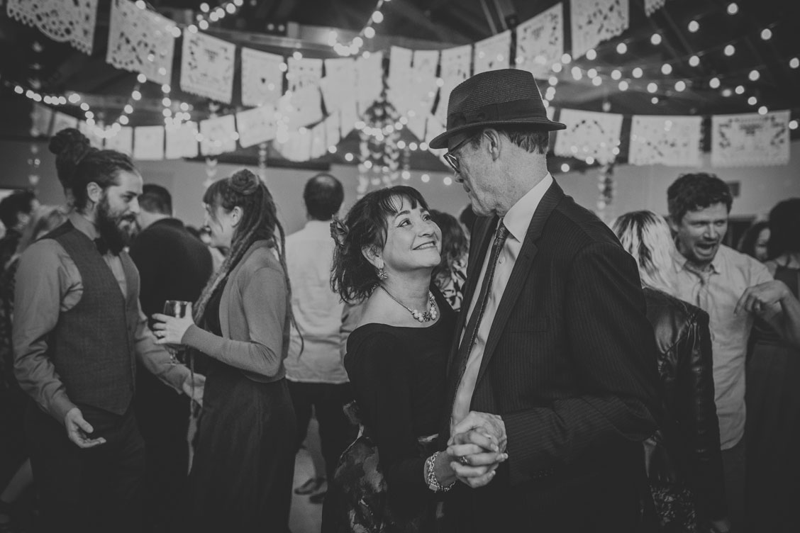 Parents of groom dancing at Stinson Beach Wedding reception by Becca Henry Photography