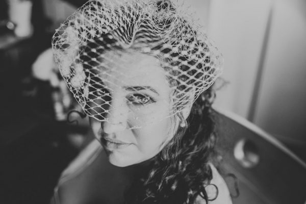 BW images of bbride who just had a make-up done at Waterfront Hotel by Becca Henry Photography.