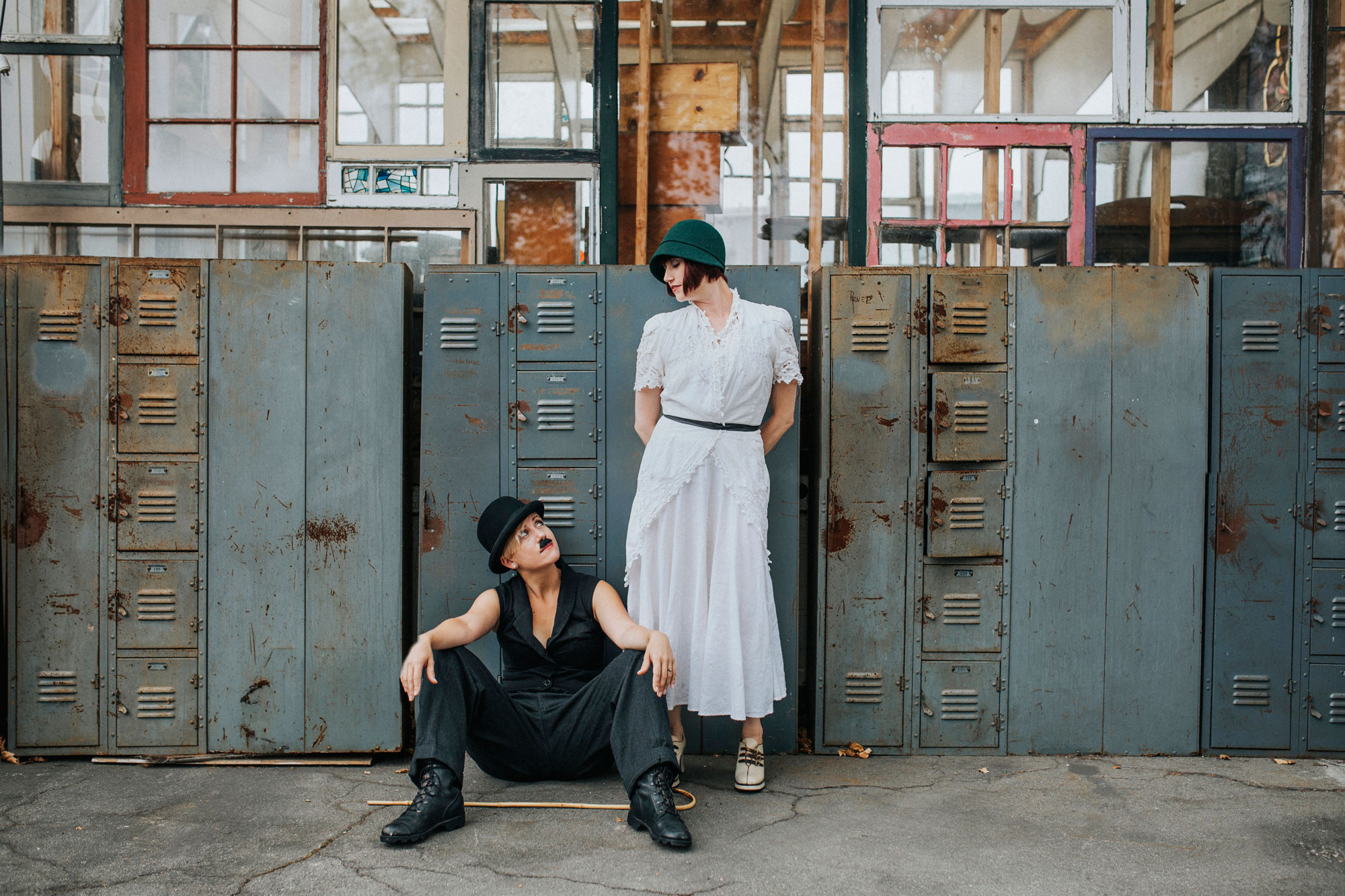 Day after wedding session at Ohmega Salvage in Berkeley- dressed as Charlie Chaplin and ingenue in front of vintage lockers by Becca Henry Photography