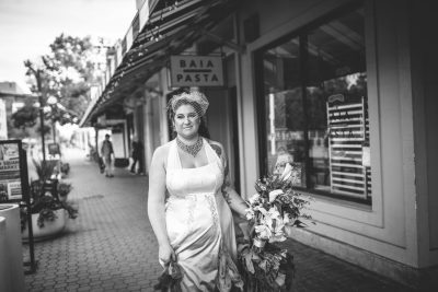 Bride walking down Jack London Square by Becca Henry Photography
