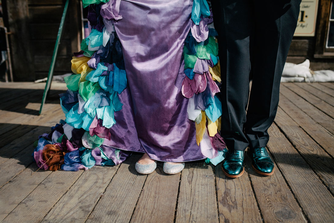 Awesome, colorful shoes of wedding couple by Becca Henry Photography
