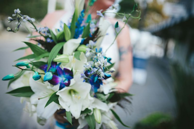 Wedding bouquet of blue and white lilies by Becca Henry Photography