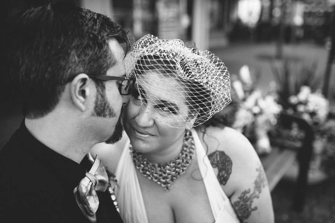 BW image of wedding couple snuggling by Becca Henry Photography