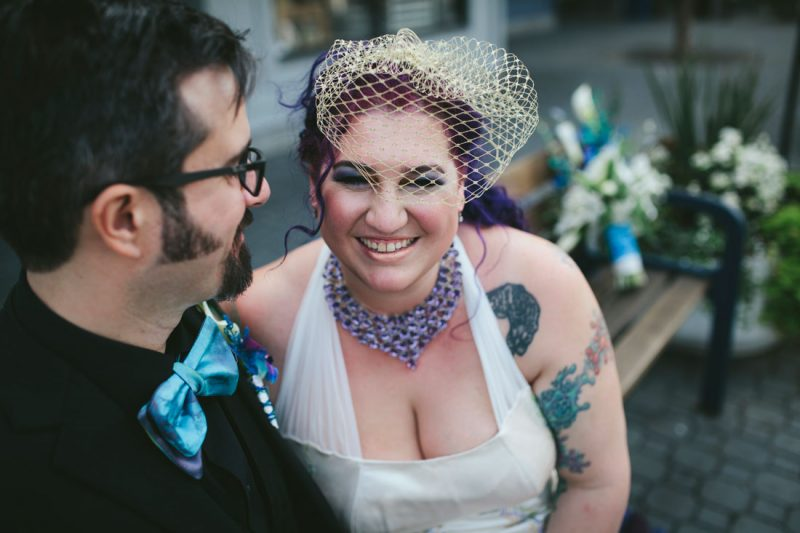 Laughing, tatted bride snuggling up to groom in Jack London by Becca Henry Photography