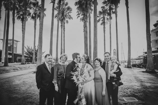BW family portrait under the palm trees in Jack London Square by Becca Henry Photography