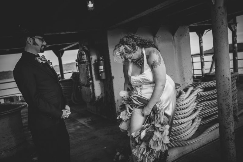 Bride fixing garter before the ceremony by Becca Henry Photography
