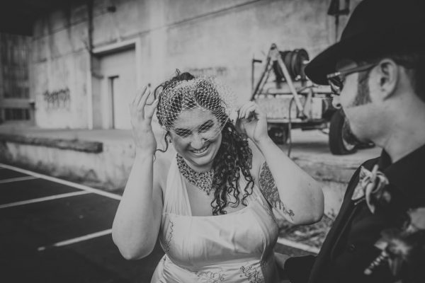 Bride fixing veil by Becca Henry Photography