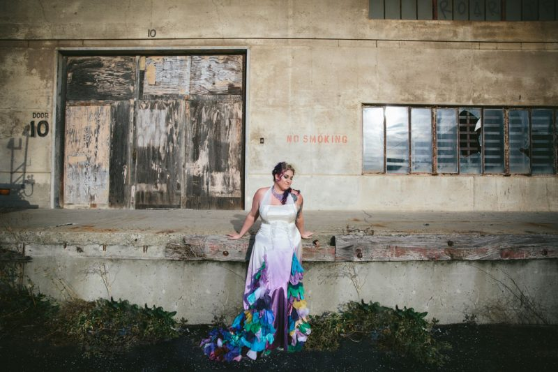 Portrait of bride with purple hair and peacock inspired dress by Becca Henry Photography