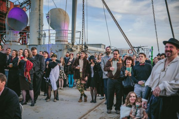 Wedding guests watching the ceremony on SS Red Oak Victory by Becca Henry Photography