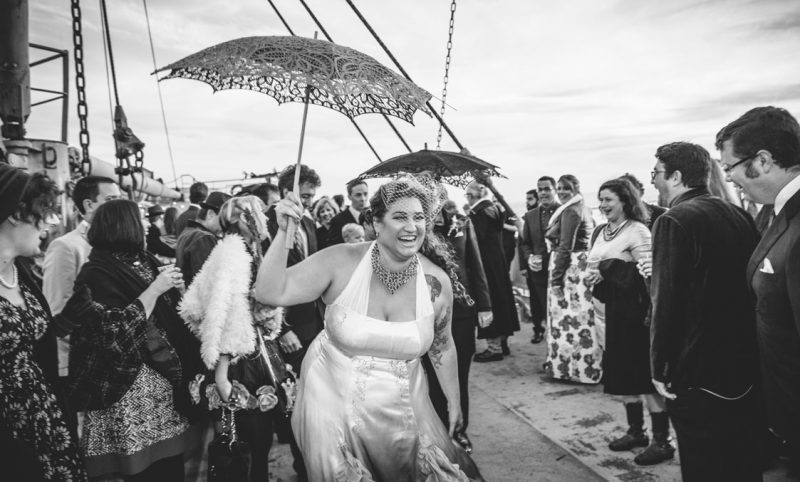 Just wed couple doing the traditional New Orleans style wedding recession dance aboard the SS Red Oak Victory by Becca Henry Photography.