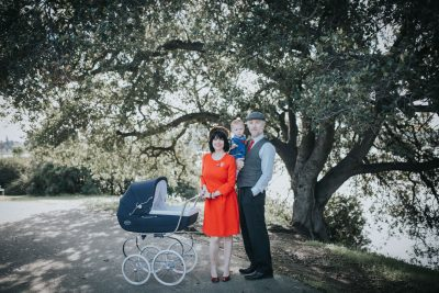 Family portrait by beautiful oak tree with antique carriage at Lake Merritt in Oakland by Becca Henry Photography