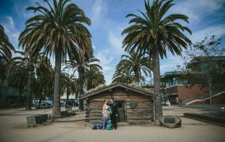 Jack London Square wedding- couple in front of oldest bar in Oakland, Heinold's.