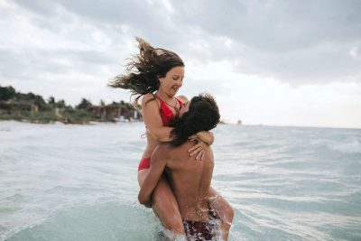 Lovers playing on a Mexican beach by Becca Henry Photography